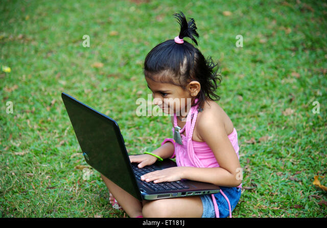 Baby working on Laptop in Happy Mood India Asia MR#736L - Stock Image