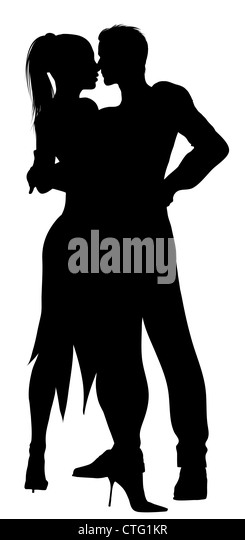 silhouette of couple dancing with passion - Stock Image