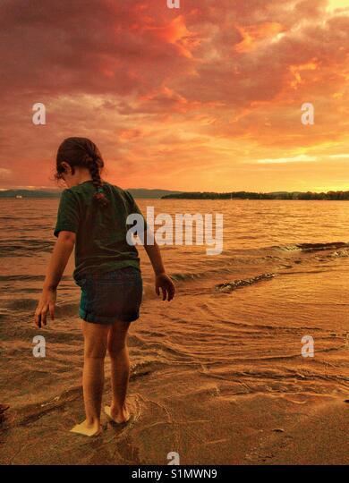 Female child on Lake Champlain at sunset in Burlington, Vermont - Stock Image