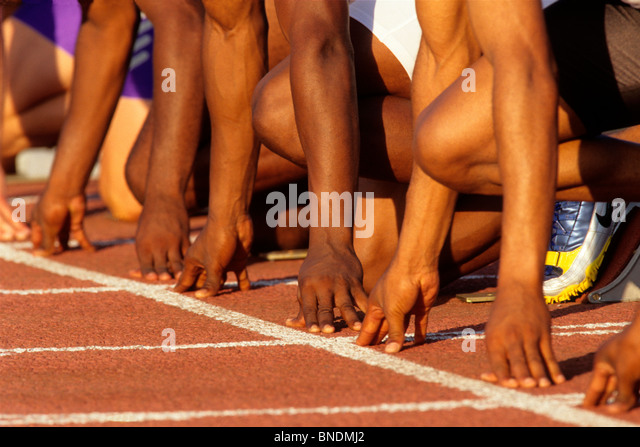 Detail of runners hands at the start of a mens 100m race. - Stock Image