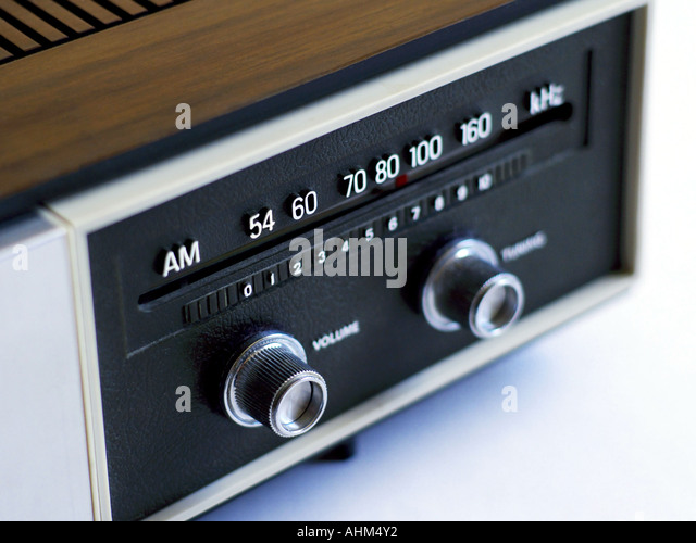 Dial and knobs on a vintage AM radio in soft light and shallow focus - Stock Image