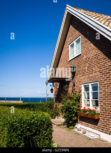 A brick house in Arild, Sweden. - Stock Image