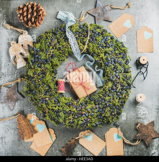 Christmas decorative wreath, wooden toys, presents, materials for making decoration - Stock Image