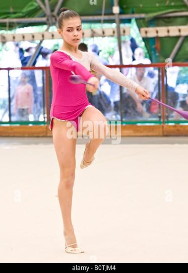 little girl rhythmic gym skittle, ninepin - Stock Image