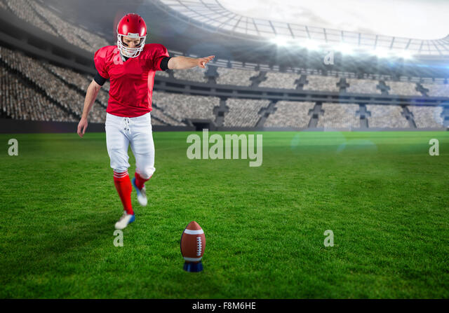 Composite image of american football player kicking football - Stock Image