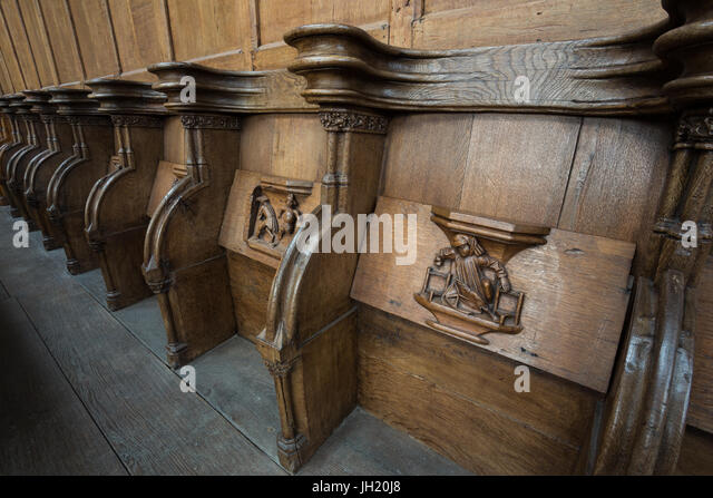 OLD CHURCH OR DE OUDE KERK, AMSTERDAM, THE NETHERLANDS - JULI 7, 2017: Old wooden misericords. - Stock Image