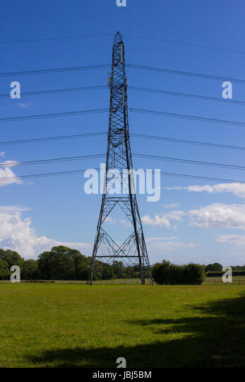 Electricity power cables and pylons stretching across the English countryside as a vital part of the National Grid - Stock Image