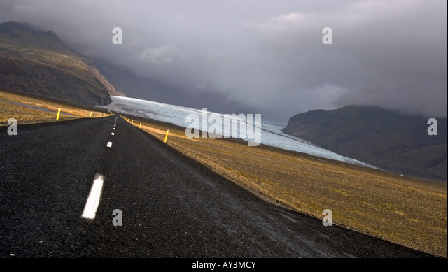 Ring road (Route 1) ending underneath a glacier in southern Iceland - Stock Image