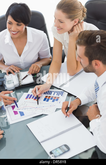 Young well dressed business people in meeting - Stock Image