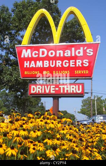 Massachusetts Cape Cod Hyannis McDonald's Hamburgers fast food restaurant sign golden arches drive-thru - Stock Image