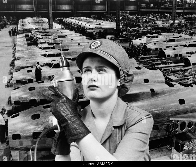 WOMAN ROSIE THE RIVETER SUPERIMPOSED OVER AIRPLANES IN FACTORY 1940s WARTIME WWII WORKER WORK - Stock Image