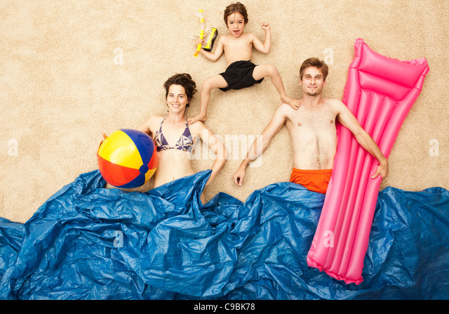 Germany, Artificial beach scene with family having fun in waves - Stock Image