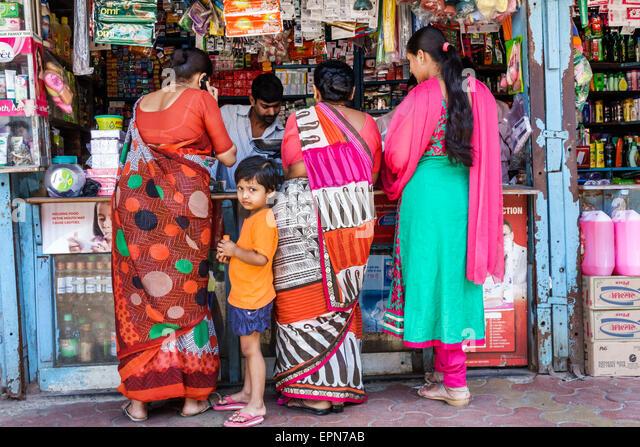 Mumbai India Asian Apollo Bandar Colaba Causeway Market Lala Nigam Road shopping street vendors stalls woman man - Stock Image