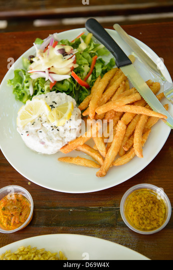 Plate of fries, dinner salad and eggs - Stock Image