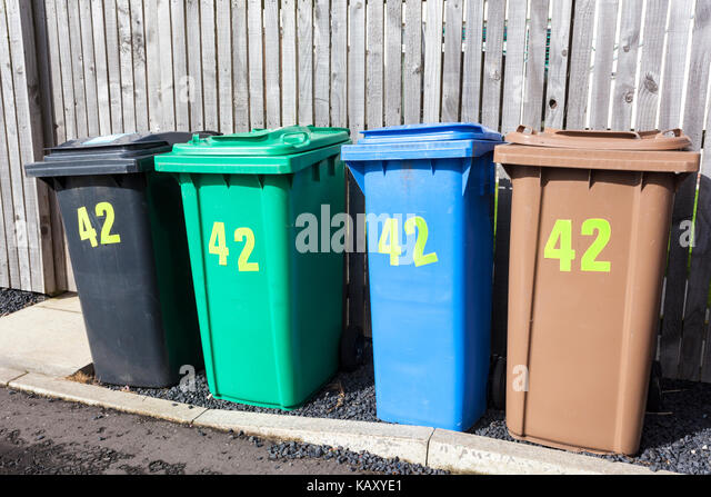 Four full sized recycling wheelie bins for one property at Anstruther, Fife, Scotland UK - Stock Image