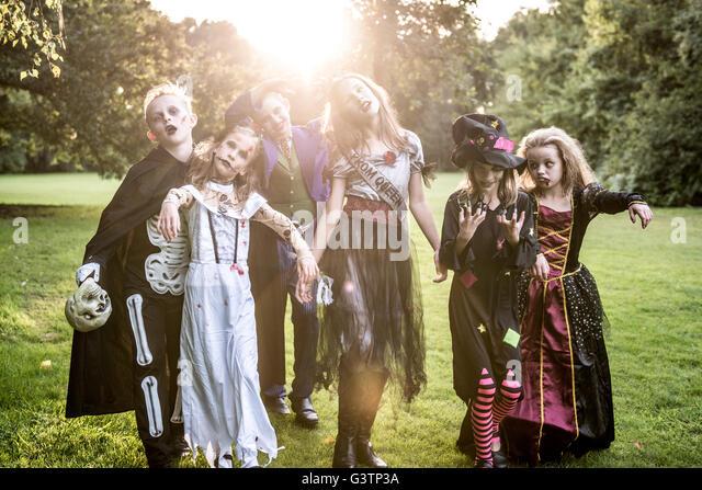 Children pose in zombie costumes for Halloween Night. - Stock-Bilder