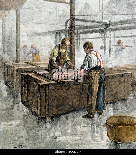 Workers in the dyeing room of a textile mill 1800s - Stock Image
