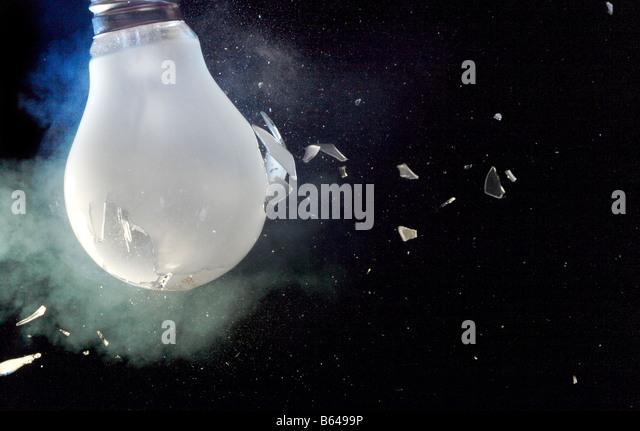 Shattering light bulb - Stock Image
