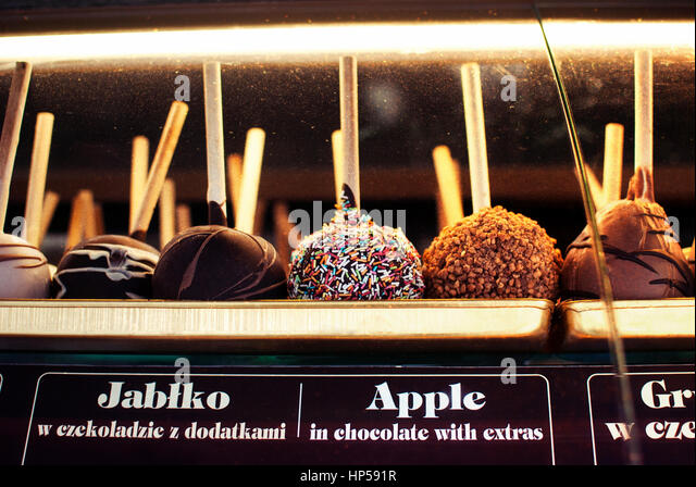 Delicious local street food taffy apple in chocolate with extras, sweets in Zakopane, Poland. - Stock Image