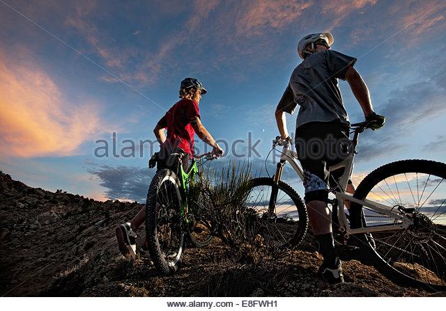 Bikers enjoying evening sky - Stock Image