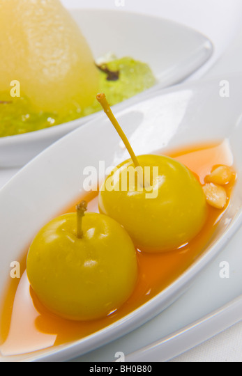 berries served in orange sauce - Stock Image