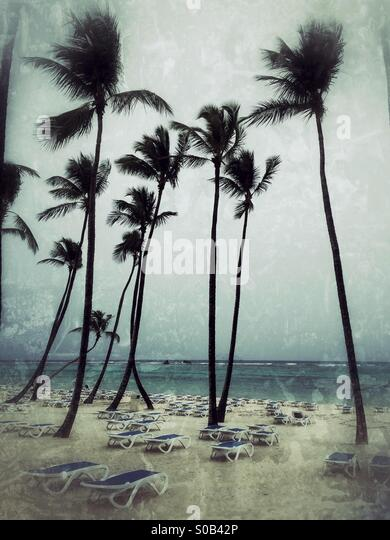 A tropical beach resort, empty on a stormy day. - Stock Image