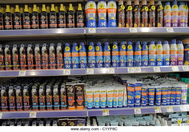 Miami Beach Florida Walgreens pharmacy drug store suntan lotion spray sunscreen block SPF skincare health cancer - Stock Image