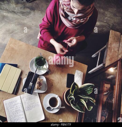 High Angle View Of Mid Adult Woman Sitting At Home - Stock Image