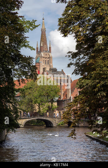View from Begijnhof towards the Church of Our Lady in the historic city of Bruges in Belgium. The city center is - Stock Image
