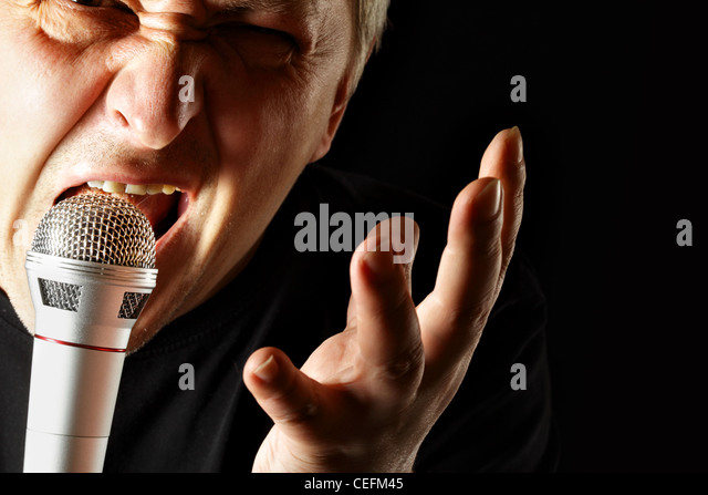 Mad crying man close-up over black background - Stock Image