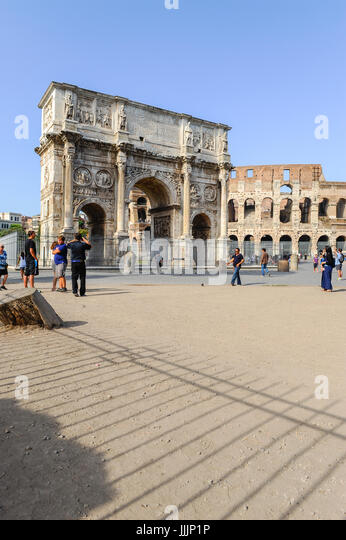 Costantino Triumphal Arch with Colosseum in the background. Rome, Italy - Stock Image