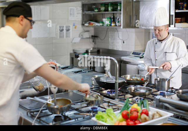 Two People In Commercial Kitchen - Stock-Bilder