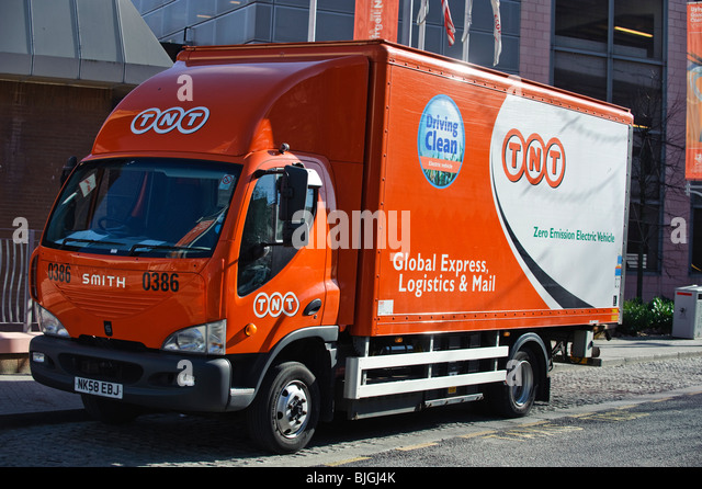 TNT Express Logistics Zero Emissions Electric powered delivery truck lorry in Cardiff Wales UK - Stock Image