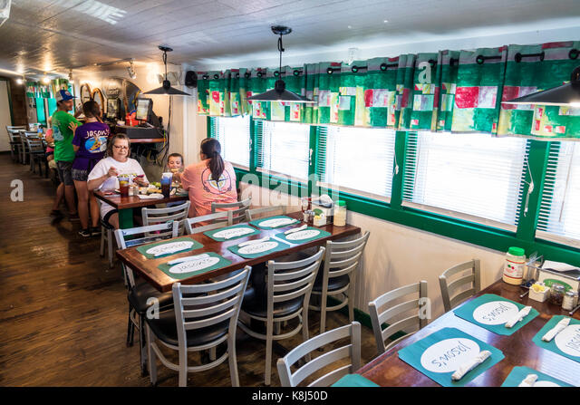 North Carolina NC Outer Banks Ocracoke Island Jason's Restaurant seafood table family dining - Stock Image