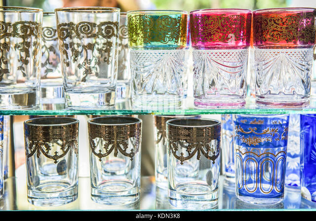 Moroccan colorful tea glasses assorted at shop window shelves - Stock Image