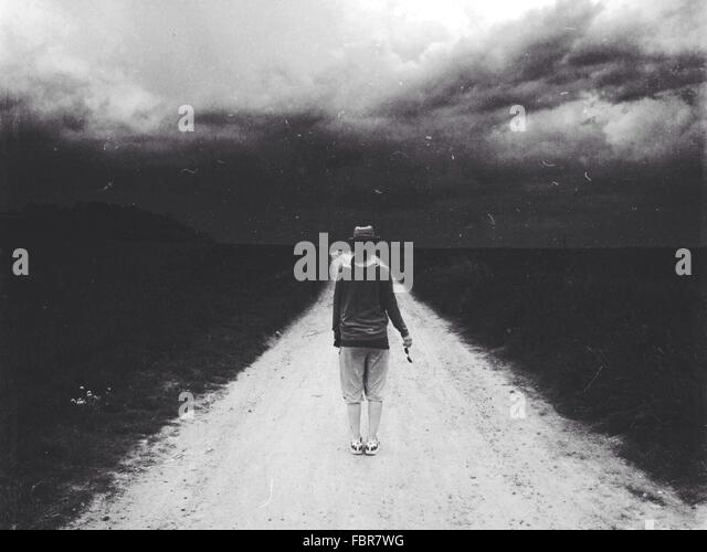 Woman Walking On Road - Stock-Bilder