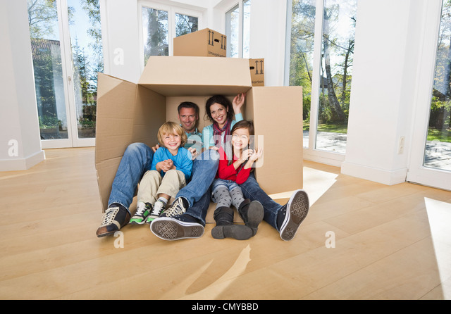 Germany, Bavaria, Grobenzell, Family having fun in house, smiling - Stock Image