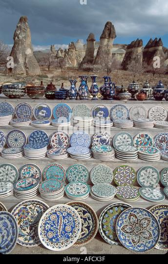 Turkey Cappadocia Zelve Valley souvenir ceramic plates & bowls fairy chimney tufa mounds beyond - Stock Image