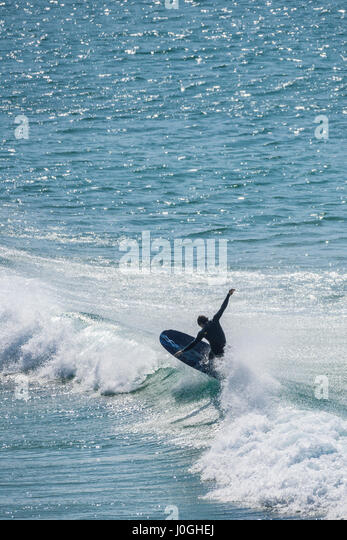 Surfer UK Sea Surfing Longboard Water Hobby Leisure activity Balance Newquay Cornwall - Stock Image