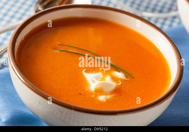 Homemade Orange Carrot Soup with Sour Cream - Stock Image