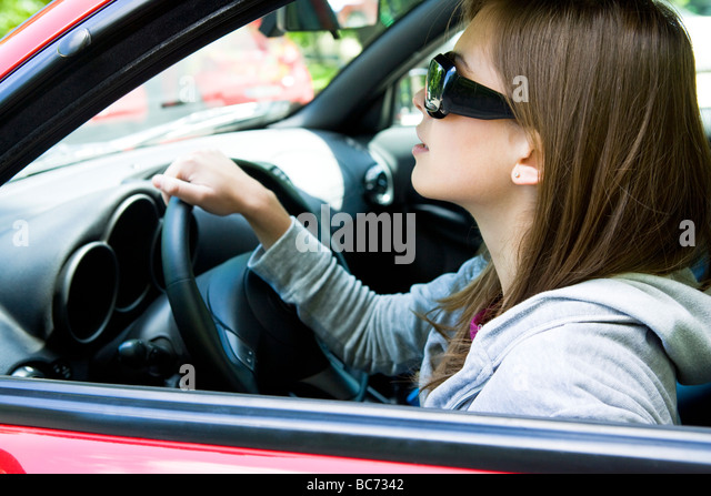 woman in sunglasses driving car - Stock Image