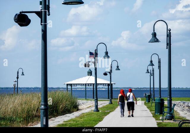 Florida St Saint Cloud Lakefront Park East Lake Tohopekaliga teen couple boy girl - Stock Image