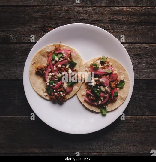 Two tacos on a plate - Stock Image