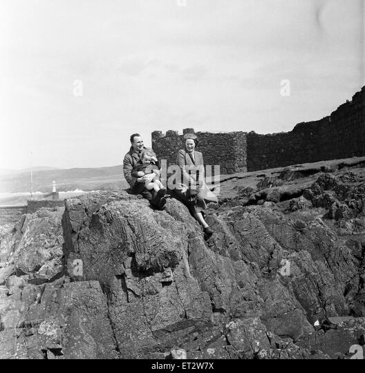 A family enjoys the view in Peel, Isle of Man. May 1954. - Stock Image