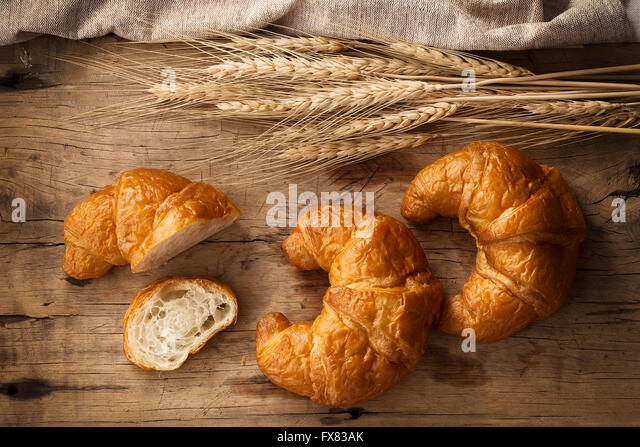 Tasty croissant still life rustic wooden background bakery breakfast brunch - Stock Image