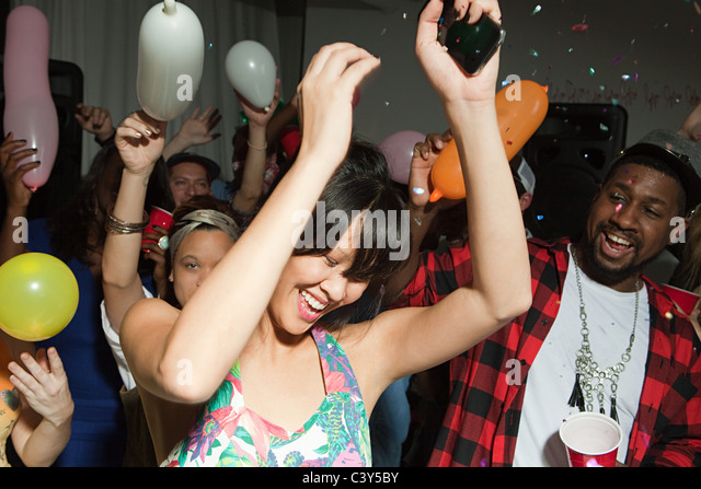 People dancing at party - Stock Image