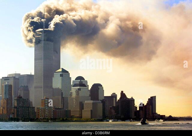 (dpa) - Clouds of smoke rise from the burning upper floors just before the twin towers of the World Trade Center - Stock Image