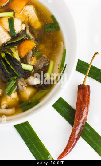 Tom Som Kai — Sour chicken soup. Lao cuisine menu soup at  Restaurant Les 3 Nagas. Luang Prabang,Laos - Stock Image
