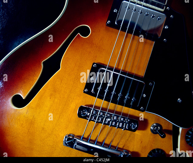 A semi-acoustic guitar - Stock Image