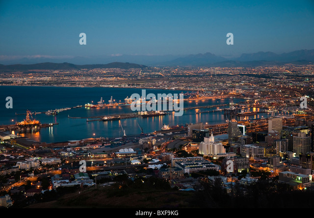 View over Cape Town at dusk showing the city lights. Cape Town. Western Province. South Africa. - Stock Image